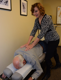 Dr. Vracin works with a patient using a flexion distraction drop table.